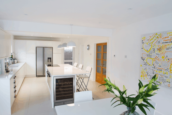 This sleek, minimal, kitchen design needed to be easy to clean with two young teenagers in this family home in Christchurch, Dorset, United Kingdom.