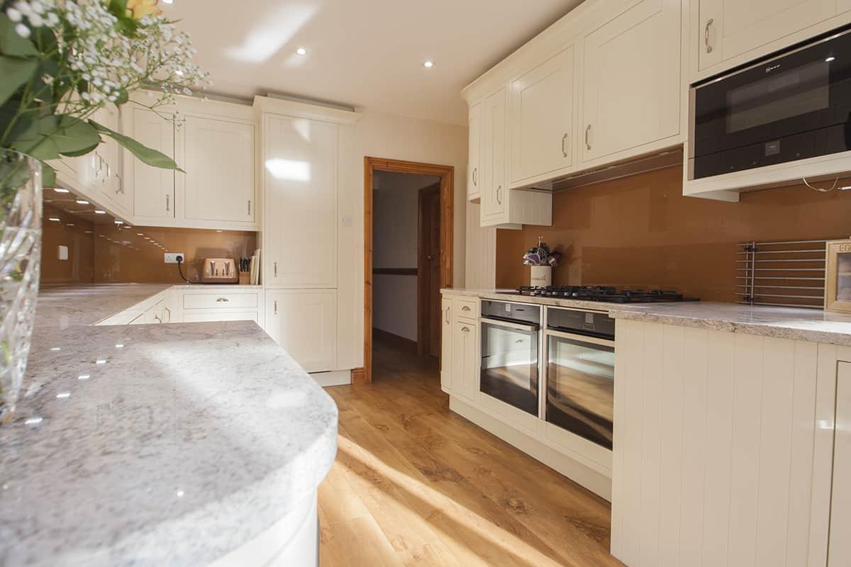 Stunning kitchen design with copper glass splash back