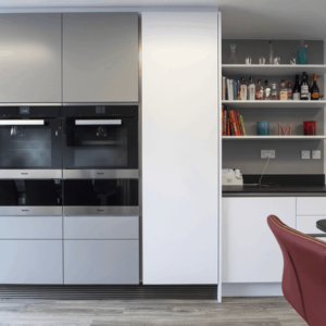 Tall bank with Miele double ovens and warming drawers