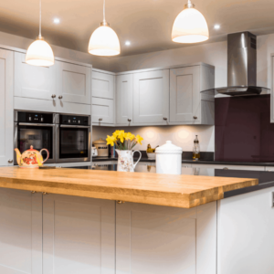 A Warm Traditional Open Plan kitchen with a splash of colour