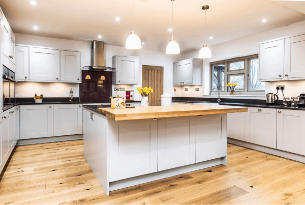 Traditional warm open plan kitchen with a aplash of colour